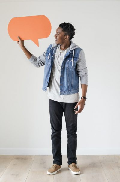 happy-african-american-man-holding-copyspace-speech-bubble.jpg