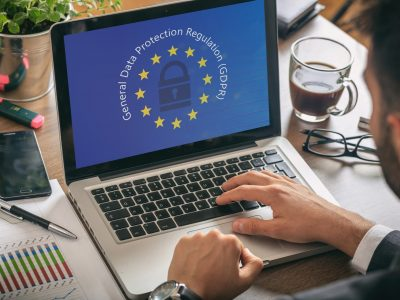 man-working-with-a-computer-general-data-protection-regulation-and-european-union-flag.jpg